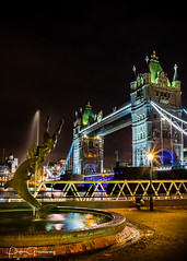 'Boy With A Dolphin' Fountain & Tower Bridge, London At Night (Peter Greenway) Tags: architecture neon southbank flickr londonatnight nightphotography lighttrails london landmark towerbridge lighttrace city lighttrail urban capitalcity night statue iconic fountain nighttime nightlights