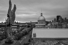 View from Notre-Dame-de-Bon-Secours Chapel - Montreal Quebec Canada (mbell1975) Tags: montréal québec canada ca view from notredamedebonsecours chapel montreal quebec sculpture statue dome angel market markt bw notre dame bon secour church city skyline cloudy cloud clouds gray wings horn