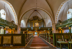 Interior of St Nicolai church (m3dborg) Tags: church interior architecture building light reconstruction window benches ceiling colorful religious religion artifacts