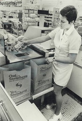 1975 Steinberg Cashier Uses a Scanner (dominion386) Tags: steinberg sacdeserviceàlauto carorder paperbag scanner cashier woman 1975 vintage