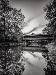 Sangamon Reflections (mjhedge) Tags: bw blackandwhite monochrome coveredbridge bridge lakeofthewoods water river reflection getolympus olympus oly omd omdem1mkii em1mkiiomdem1markii 714mm mzuiko714mmf28pro sangamon mahomet