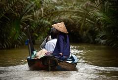 Island Travel, Mekong River (Ginger H Robinson) Tags: island travel transportation boat sandisland mekongriver bentreprovince vietnam southeastasia water watercoconuts bamboo plant nonle conicalhat