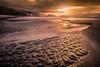 Furrows of past, lights of future. (Emykla) Tags: alba sunrise raggi rays nikon d3100 napoli italia italy mare sea nuvole clouds dorato golden sabbia sand scogli rocks yellow giallo