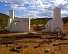 Chimneys (Padmacara) Tags: australia g11 owensprings homestead ruin stone dirt sky clouds