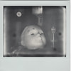 Asleep at the wheel, it spins. (helioshamash) Tags: polaroid spectra impossible film monochrome black white los angeles instant expired