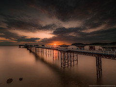 First Light At Llandudno Pier (Richard Walker Photography) Tags: jetty coast longexposure llandudno landscape landscapephotography nature beach sunrise wales clouds sun sea rocks sky