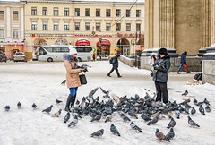 Saint Petersburg, Russia, January 16, 2016. Two women feeding pigeons near the Kazan cathedral. (g_reg_walker) Tags: russia cold cathedral historical perspective travel excursion landmark attraction history saint people sights dove church feeding sightseeing pigeon architecture woman winter frost prospect trip snow kazan cityscape petersburg
