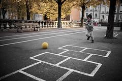 An old school : the yellow ball #4 (richardtostain) Tags: école school rue street jeu ballon enfant candid scene pentax limited 31mm