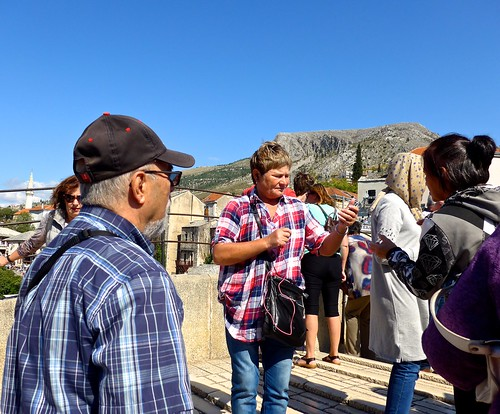 Ali joins other tourists on the Old Bridge, Mostar