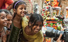 Happiness (jayant0v) Tags: children happy posing camera many india indian happiness playing girl women