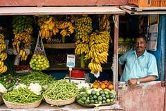 Shop owner and his shop. (hadogumu) Tags: 印度 fruit vegetable market shop india kerala munnar travel 35mm sel35f28z fe35f28za fe35 zeiss a7rm2 a7rii alpha sony