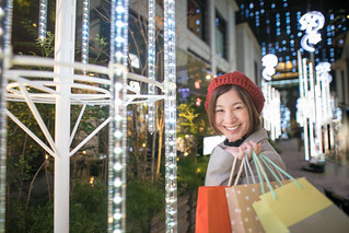 Happy young woman shopping at Christmas night