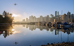 Morning Fly-by (Sworldguy) Tags: vancouver floatplane harbour water waterfront reflections cityscape tourism downtown morning autumn seaplane boats shoreline britishcolumbia bc nikon d7000 dslr marine serene