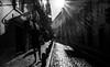 sunburst in the city (ThorstenKoch) Tags: street streetphotography stadt strasse schatten shadow silhouette schwarzweiss summer sun sonne sky sunburst licht lights lines linien light lissabon lisboa lisbon fuji fujifilm xt10 thorstenkoch monochrome outdoor tuesday pov blackwhite bnw portugal