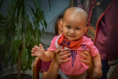 The beauty of life does not depend on how happy you are, but how happy others can be because of you. (J316) Tags: baby toddler cheeks smile joy happy laughter eyes thailand chiangmai j316 a77 sony tamron potraiture candid