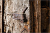 Rusty latch on an old barn door (ronnymariano) Tags: color latch old lock brown woodmaterial entrance door backgrounds obsolete 2017 colors weathered dirty retrostyled house rusty closeup gate antique oldfashioned rustic metal