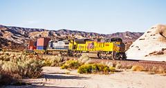 CSX7524+UP8414 acting as DPUs to a heavy eastbound autorack and manifest train recorded passing Mormon roacks, Pine Lodge. 17September2009 (mikul44171) Tags: 7525 csx7524 mormonrocks cajonpass autorack manifest 8414 up8414