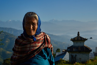 Newari old woman in front of Himalaya Range, Dulikhel, Katmandu Valley, Nepal