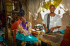 Tailors at work in Bamako, Mali. (Phototravelography) Tags: africa bamako mali portrait westafrica cloth colourful environment fabrics man person profession sewing sewingmachine tailor teamwork work