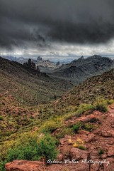 Superstition Mountain Wilderness (bijoularry) Tags: ominousskies darkclouds impendingthunderstorm mountainouslandscape rocks boulders steep cliffs stones mountainsides darkness desert vegetation superstitionmountainwilderness arizona