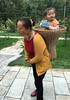 Baby in a Basket (cowyeow) Tags: shennongjiaforestrydistrict composition asia asian china chinese shennongjia people farmers hubei portrait lady woman chinesewoman basket baby mother family candid