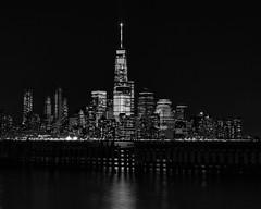 Freedom (Darren LoPrinzi) Tags: 5d canon5d canon miii blackandwhite mono skyline cityscape nyc ny newyork newyorkcity manhattan lowermanhattan hudson hudsonriver lowkey dark freedomtower skyscraper skyscrapers buildings lights windows pier nj newjersey