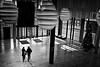 to the exit (heinzkren) Tags: wien vienna indoor street streetphotography candid urban people couple paar personen panasonic lumix schwarzweis blackandwhite bw monochrome beleuchtung light shadow schatten licht linien lines christbaum wienerberg silhouette