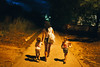 Girls going home (mravcolev) Tags: portrait girls mother daughters night lamp summer shadows canoneos5dmarkii 5dmkii 5d2 35l canonef35mmf14lusm
