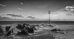 The incoming tide (David Feuerhelm) Tags: nikkor clouds rocks bouy contrast wideangle blackandwhite bw monochrome noiretblanc schwarzundweiss longexposure leefilters silverefex nikon d750 nikkor1635mmf4 caistoronsea norfolk coast england