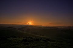 Some Days Never End (Kevin_Jeffries) Tags: nikond800 nikkor kevinjeffries sunset haze mist newzealand southisland somedaysneverend moody canterbury sun sunlight adobergb geotagged 240850mmf3545 pasture hills waitakivalley