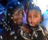 MOTHER AND CHILD IN A SHELTER ON A RAINY DAY AT CHENNAI MARINA (vijvijvij) Tags: rainyday marinabeach shelter