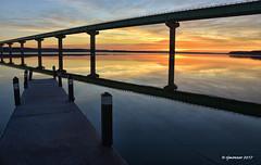 Saylorville Lake_176438 (rjmonner) Tags: lake reflection sunrise iowa midwest cornbelt mirror dock bridge tranquil peaceful nature natural fishing transportation recreation