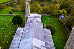 View along the roof to the east tower. (rustyruth1959) Tags: nikon nikond5600 sigma1020mm uk england eastanglia norfolk blakeney stnicholaschurchblakeney churchtower westtower easttower churchroof roofview rooftiles church architecture religiousbuilding building churchyard structure grounds graves headstones tombstones grass trees autumnleaves arch stonework pinnacles cross