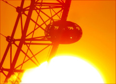 London Eye`Sunset (roll the dice) Tags: london sun colours uk sunset art classic urban waterloo sky england passengers pod magic ferriswheel canon tourism tourists people natural view southbank riverthames capsule cocacola expensive surreal mad birds lambeth se1 high tall dark millenniumwheel fireworks skyline dusk bright landscape crowd busy reflection hot cold sunny weather zoom seethru happy christmas