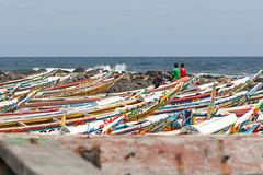 Amongst the Boats, Dakar (Geraint Rowland Photography) Tags: clouds colourful colourfulafrica yoffbeach dakar senegal africanfashion football footballfashion footballshirts fishing fishingboats colourfulfishingboatsinsenegal travel geraintrowlandphotography travelblog travelinwestafrica depthoffieldinphotography ocean beach beachliving canon fishingboat