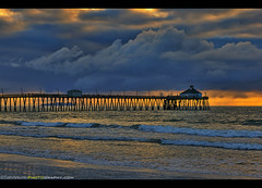 Stormy clouds over the Pacific Ocean (Sam Antonio Photography) Tags: imperialbeach sky pier clouds sunset beautiful california scenic waves water landscape beach scenery sand shore travel twilight surf nice seascape sea shoreline composition color horizon destination afterglow boardwalk vibrant canoneos5dmarkii perspective pacificocean sandiego imperialbeachpier tourism waterfront silhouette fishing cloudscape architectural architecture nature