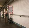 Subway Evangelist (UrbanphotoZ) Tags: woman evangelist fliers sign glasses hat longskirt backpack subway tunnel posters jesus judgment 666 wakeup insight god bless savior timessquare westside midtown manhattan newyorkcity newyork nyc ny