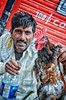 Buy this chicken! (Pejasar) Tags: merchant buy india newdelhi waterbottle market chicken man