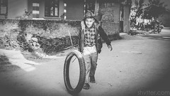 Untitled (#Weybridge Photographer) Tags: canon slr dslr eos 5d mk ii nepal kathmandu asia mkii boy child tyre tire play playing monochrome