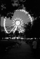 Paris: Nocturnes (McFarlaneImaging) Tags: 2015 35mm 400 analog bw blackandwhite canon carrousel cityoflights dilutionb europe eurotrip fd ftb ferriswheel film france fromage hc110 homedeveloping iso400 kodak mci night paris slr silhouette travel trix tuilleries vacation mcfarlaneimagingcom îledefrance fr
