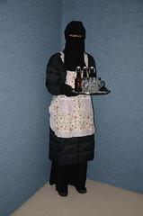 Slave Waitress (Warm Clothes Fetish) Tags: slave maid sweat warm hot winter coat boots apron girl niqab hijab burka chador torture fleece fur hat waitress