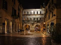 Porta dei Borsari at night (Tiigra) Tags: verona veneto italy it 2011 antiquity architecture balcony city light night portal rain road ruin texture wall window pattern arch