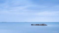 Arromanches-les-bains: witness of World War II (crispin52) Tags: france normandy arromanches beach goldbeach secondworldwar seascape blue nikon