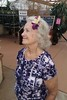 Mom posing with flowers in her hair (BarryFackler) Tags: akatsukaorchidgardens orchids flowers ornamentalplants mom pennyfackler pennyspangler penny flowershop petals blooms blossoms beautiful colorful botany volcano volcanohawaii volcanohi family momsvisit2017 indoor vacation smile smiling people plants hawaii hawaiiisland hawaiicounty bigisland polynesia sandwichislands 2017 hawaiianislands barryfackler barronfackler