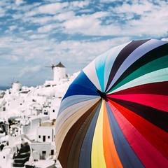 Sunblocker (One_Penny) Tags: aegean greece griechenland island santorin santorini canon6d travel umbrella colors stripes sky colorful oia windmill square crop squarecrop sunblocker colorwheel rainbow rainbowcolors view