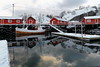 Snow covered harbor-Nusfjord fishing village-fishing boat moored in. Flakstadoya-Lofoten-Norway. 0492-2 (rweisswald) Tags: fishingboat motorboat ship fishingport fishingindustry commercialfishing sportfishing harbor berth pier snowcovered woodenpile pillar gangplank moored moorage mooring redcottage warehouse storehouse rorbu rorbuer fishinghut seahouse stilthouse floatingpontoon darkwater stillwater calmwater stillness reflection shipdeck bow stern port starboard closeddoor tire fence railing casementwindow cold winter nusfjord snow snowy flakstadoya lofoten nordlandfylke norway