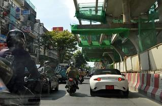 new mazda sports car in traffic