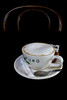 Anyone For Coffee? (No. 2) (natures-pencil) Tags: chair blackbackground cup saucer spoon sachet teaspoon coffee sugar froth cappucino puro advertising beverage drink refreshment stimulant caffeine biscuit coaster teacup