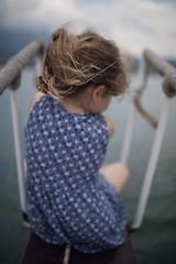 Meditation (Jessica on prow of boat), Dalyan (flatworldsedge) Tags: jessica boat prow dress meditation dalian turkey blurred background