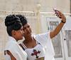 Cellphone, cellphone in my hand, who is the most beautiful among the friends? (ybiberman) Tags: israel jerusalem ethiopianchurch ethiopiancathedral wedding selfie women veil cellphone nailpolish hairdress portrait candid streetphotography white
